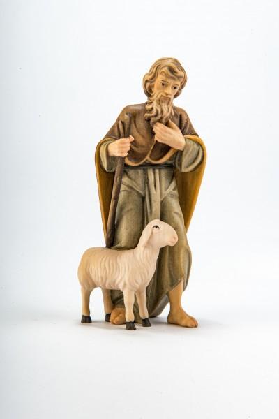 Hirte mit Stock und Schaf